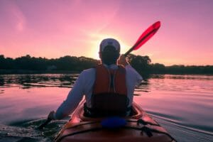 man kayaking sunset best recreational kayaks under $500