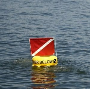 red and white diver down flag on buoy divers safety