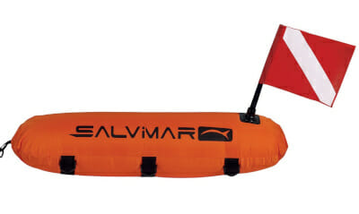 bright orange torpedo shaped spearfishing buoy with diver flag