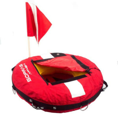 bright red freediving and scuba diving float displaying diver down flag