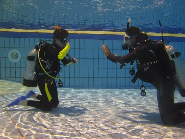 scuba divers in pool training
