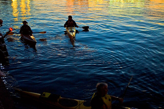 kayakers at sunset on the water