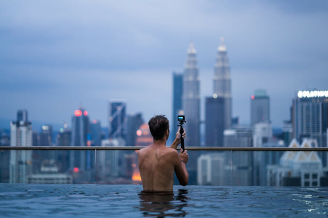 man in pool with gopro and floating handle