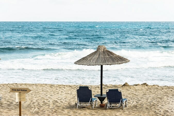 two beach chairs with umbrella on remote beach