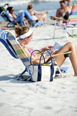 girl sitting in beach chair at the beach
