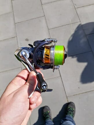 fishing spinning reel with bright green fishing line