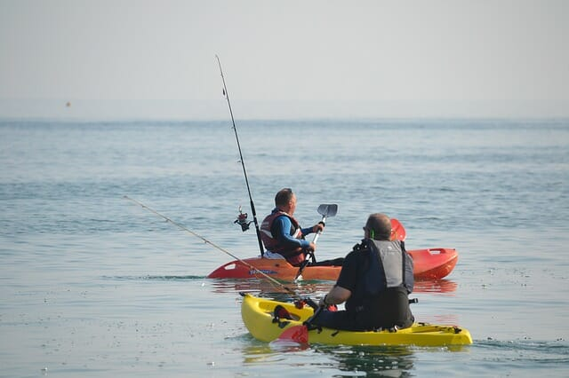 two kayak anglers in sit on top fishing kayaks