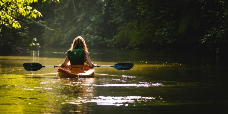 woman in recreational kayak with paddle