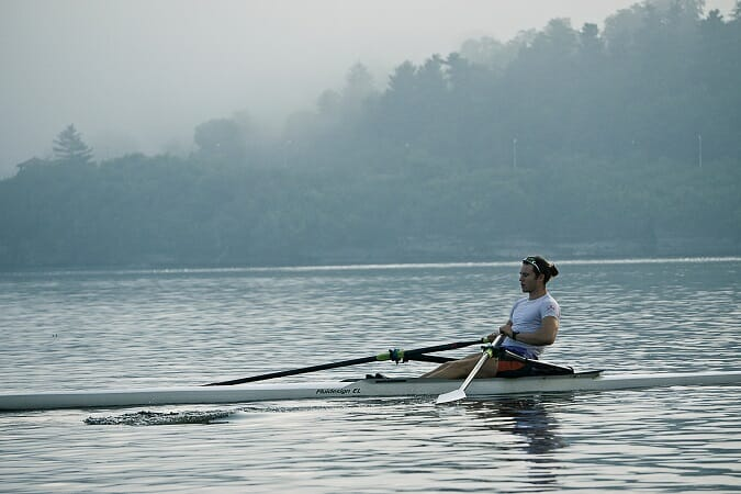 man rowing scull solo