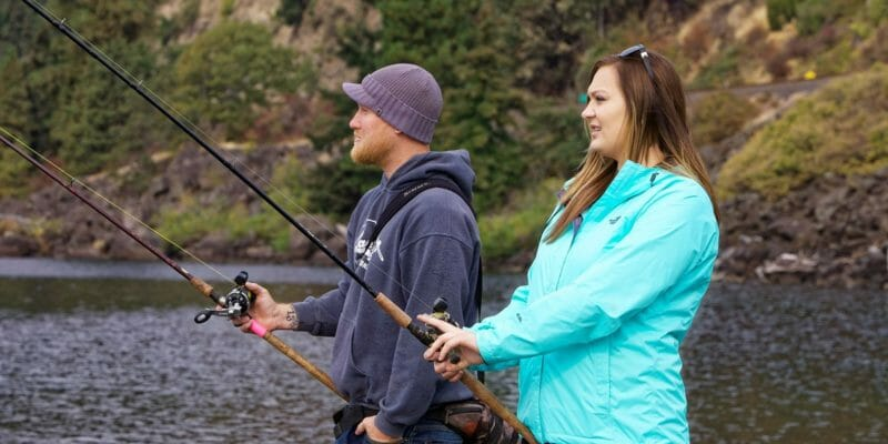 two anglers fishing for salmon in river