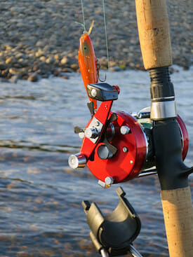 red baitcasting reel and rod with rod holder