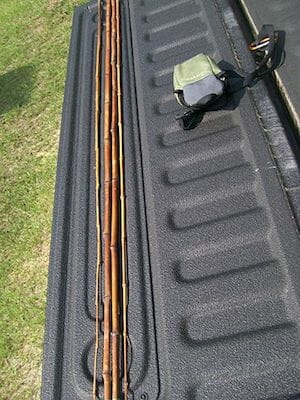 bamboo cane fishing pole on truckbed