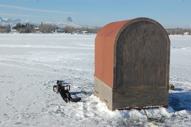 ice fishing hut and ice auger