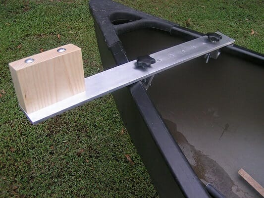 canoe trolling motor bracket attached to canoe on grass