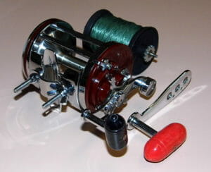 trolling reel with spool of green fishing line