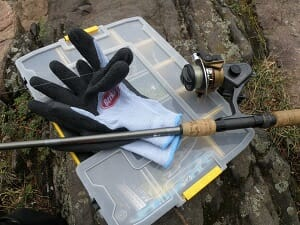 cold weather fishing gloves with rod and reel and tackle box