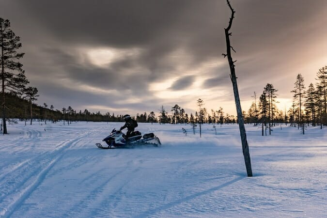 man on snowmobile sweden lapland