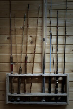 wooden rod rack on wall