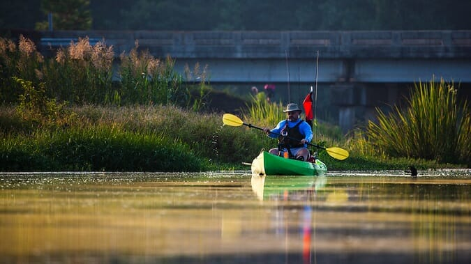kayak fisherman paddling