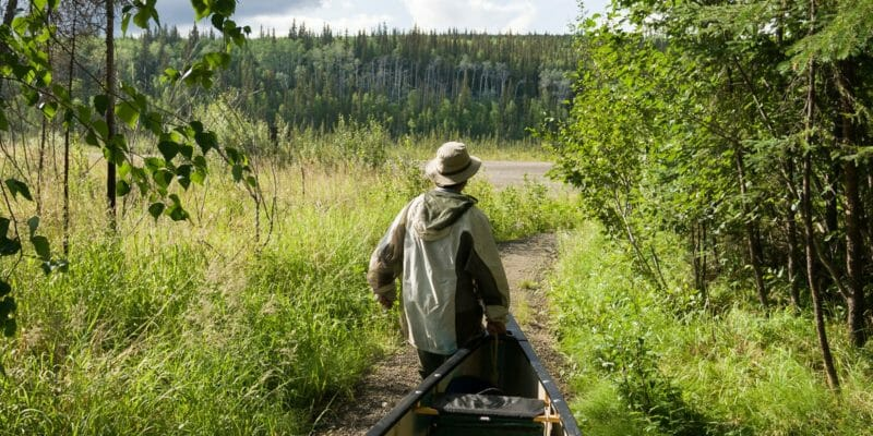 man carrying canoe portage