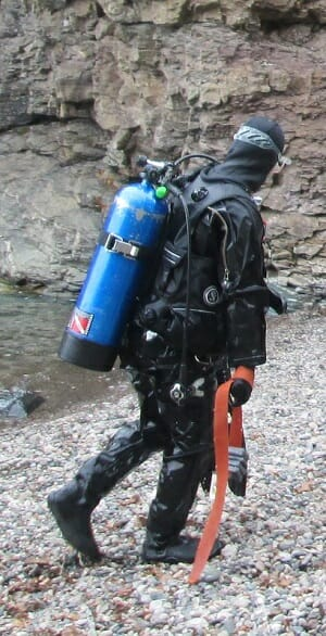 diver with drysuit on shore