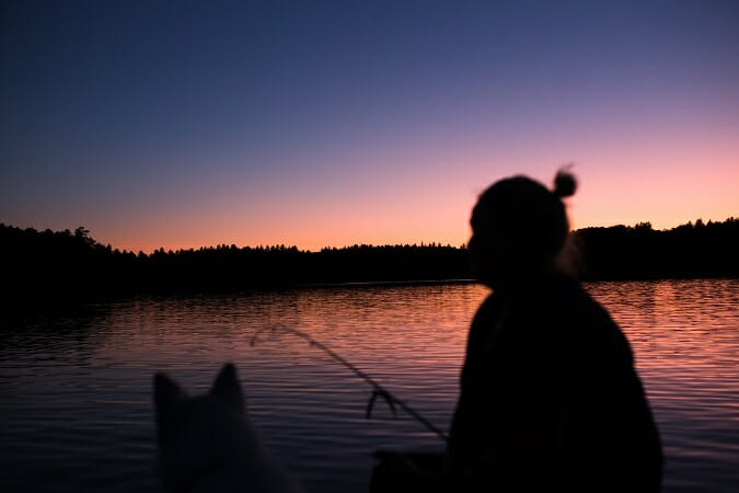 survival fishing rod at dusk