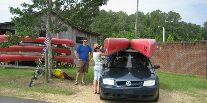 can with two canoes mounted on its canoe carrier