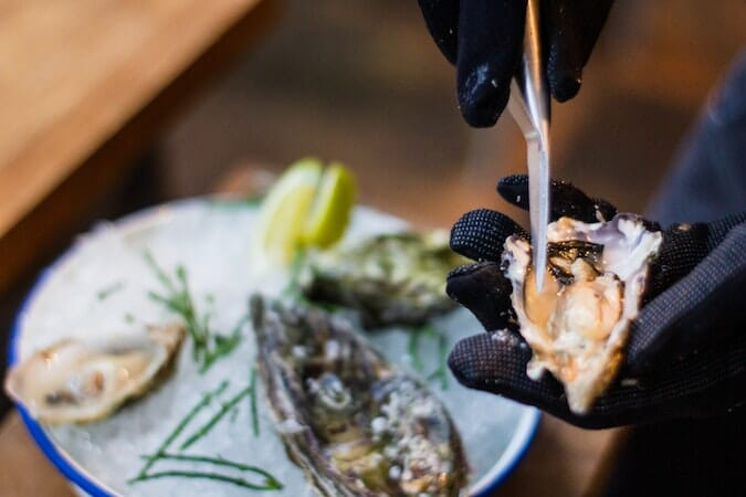shucking oysters up close