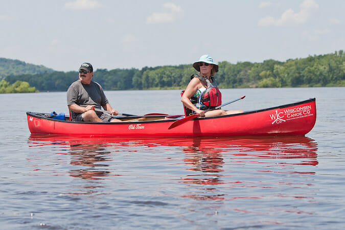 two paddlers in red canoe