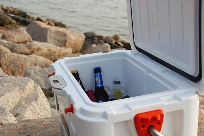 cooler full of beer by the water