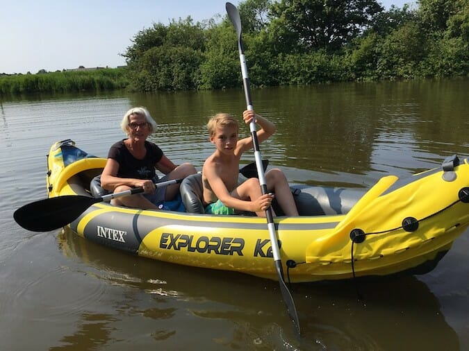 tandem infltable kayak on the water with two paddlers