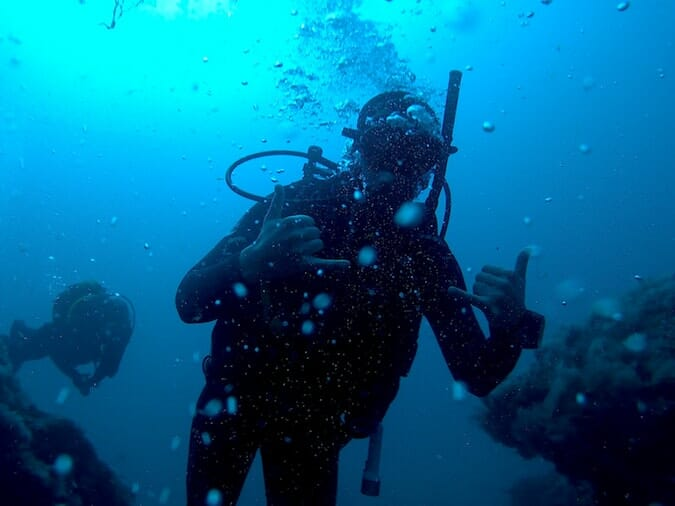 scuba diver giving hand sign