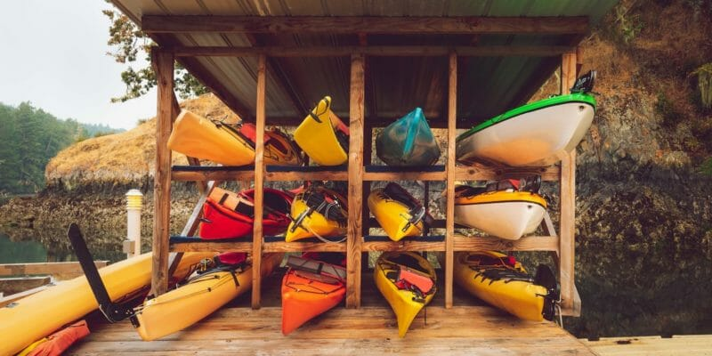 kayaks stored in rack outdoors