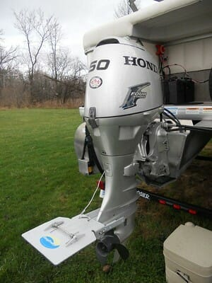 outboard motor with trolling plate attached