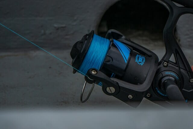 blue fishing line on spinning reel